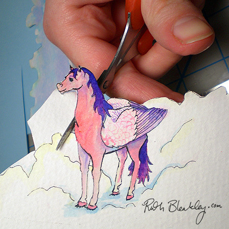 Using small scissors I carefully cut out my drawings of the flying horses - handmade diorama by Ruth Bleakley