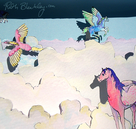 The sunlight hitting the cutouts makes beautiful shadows - handmade pegasus diorama by Ruth Bleakley