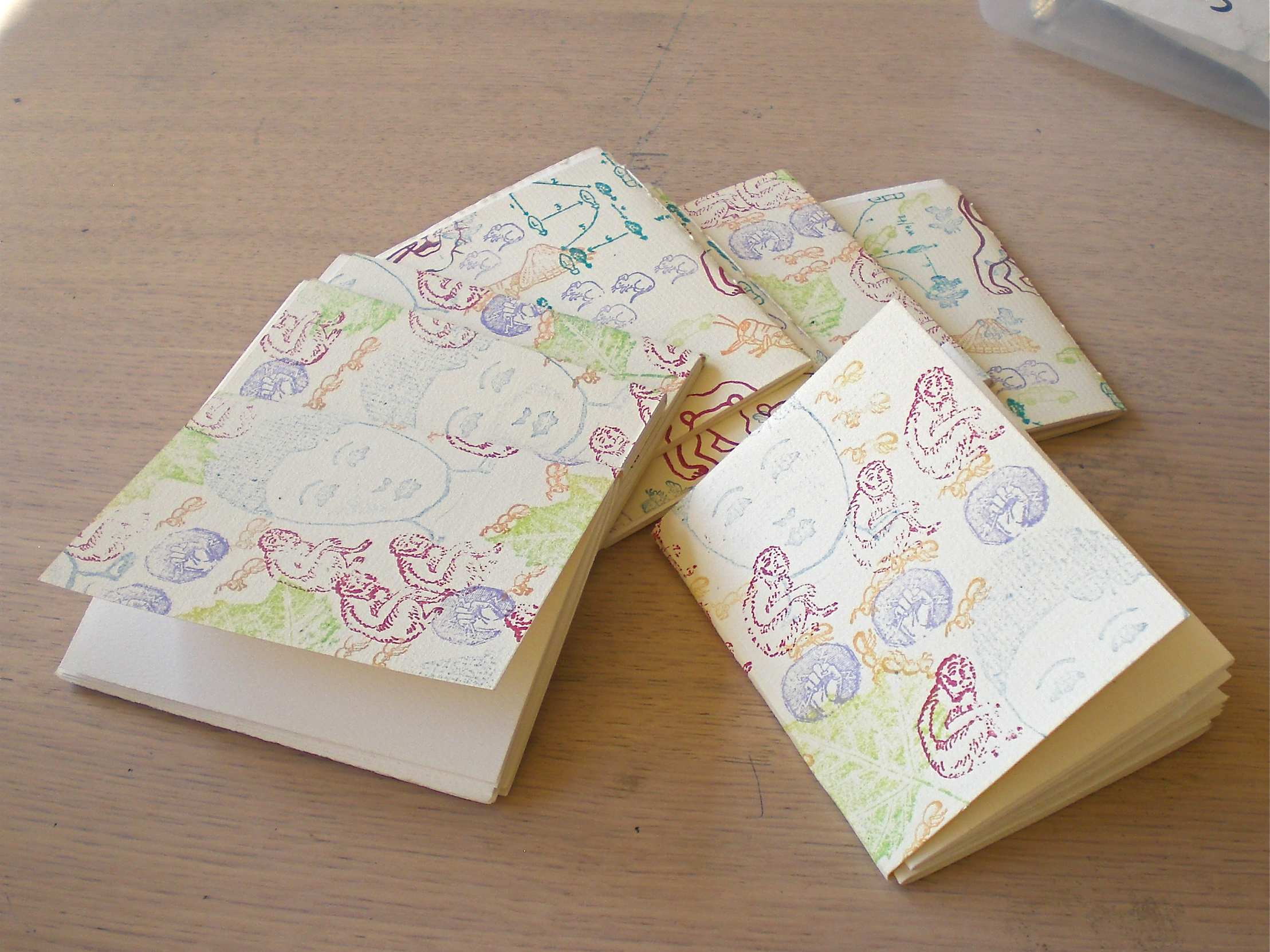 Hand Stamped pamphlet stitch notebooks made at the IPRC in 2009