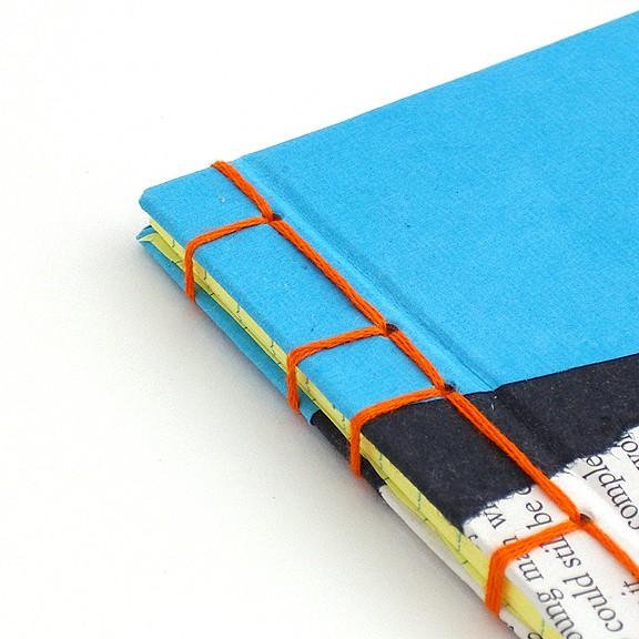 Orange and Blue Stab Binding by Ruth Bleakley