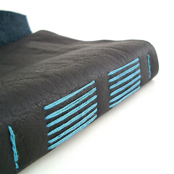 Black leather longstitch journal with blue stitching by bookbinder Ruth Bleakley