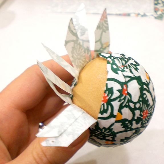 Washi Paper Decoupage Easter Egg Directions - applying paper strips with nori paste