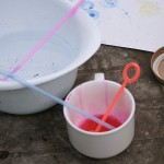 A small cup for ink and bubbles, a large bowl of water for cleaning straws