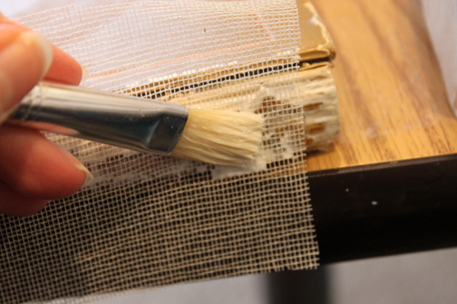 Step by Step photos of a Cookbook Repair by Ruth Bleakley - glueing new spine cloth on