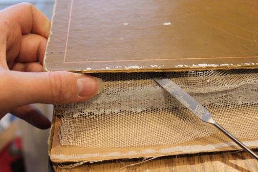 Step by Step photos of a Cookbook Repair by Ruth Bleakley - attaching text block to covers