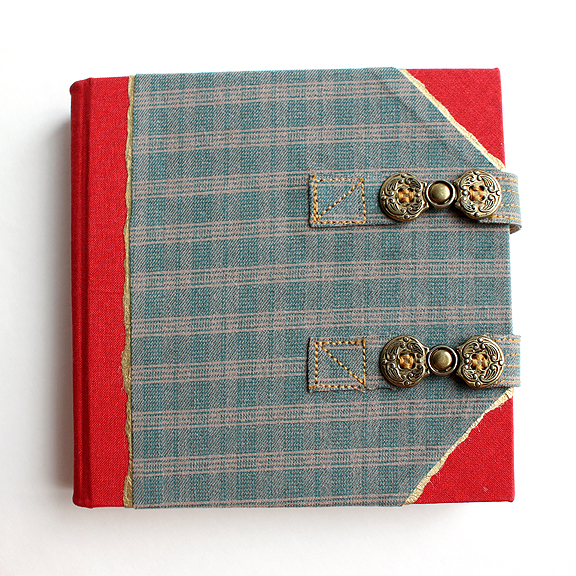 "Matt's Travel Journal - handmade by Ruth Bleakley from repurposed plaid shorts - The book is 6 1/4"" square and features antique brass toggles"