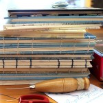 Stack of Coptic Bound Guest Books
