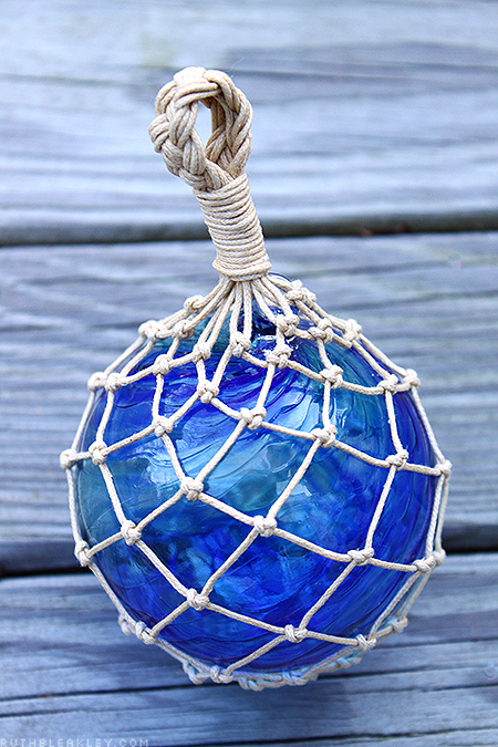 hand tied net around a hand blown glass float made by Bryan Randa