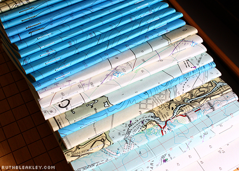 Handmade nautical chart booklets in a row by Ruth Bleakley
