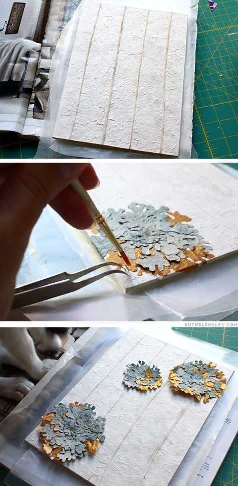 attaching the paper lichens to the book cover - Rock Wall Accordion Book Part 5 by Ruth Bleakley and Chelsea Clarke