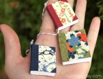 Handful of handmade book Christmas tree ornaments by Ruth Bleakley
