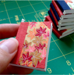 tiny book ornaments handmade by bookbinder Ruth Bleakley