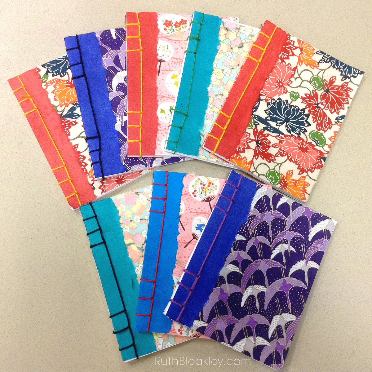 Chiyogami Japanese Stab Binding Notebooks made by a class taught by Ruth Bleakley in Florida