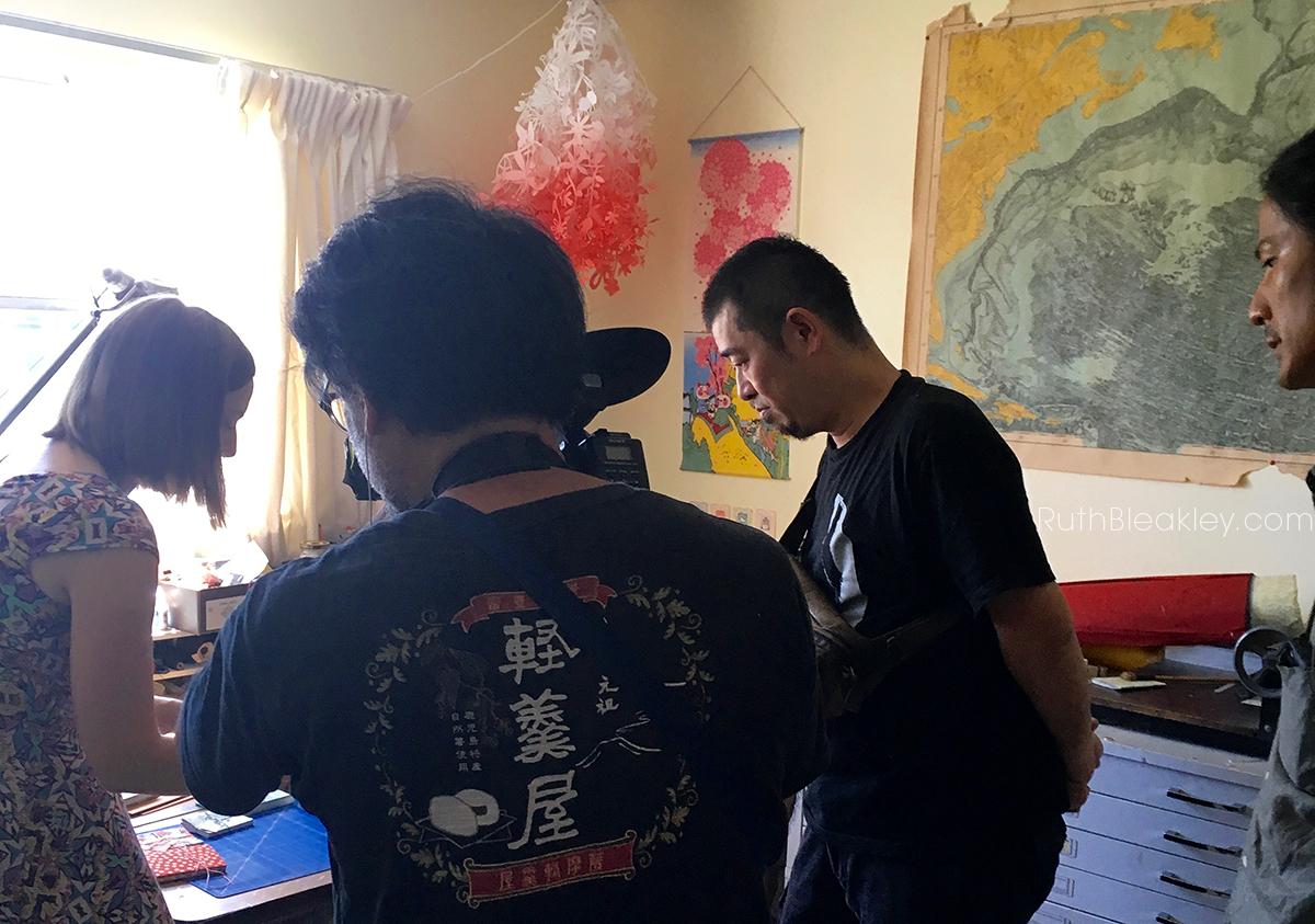 Ruth Bleakley in the studio demonstrating watoji bookbinding for Japanese TV