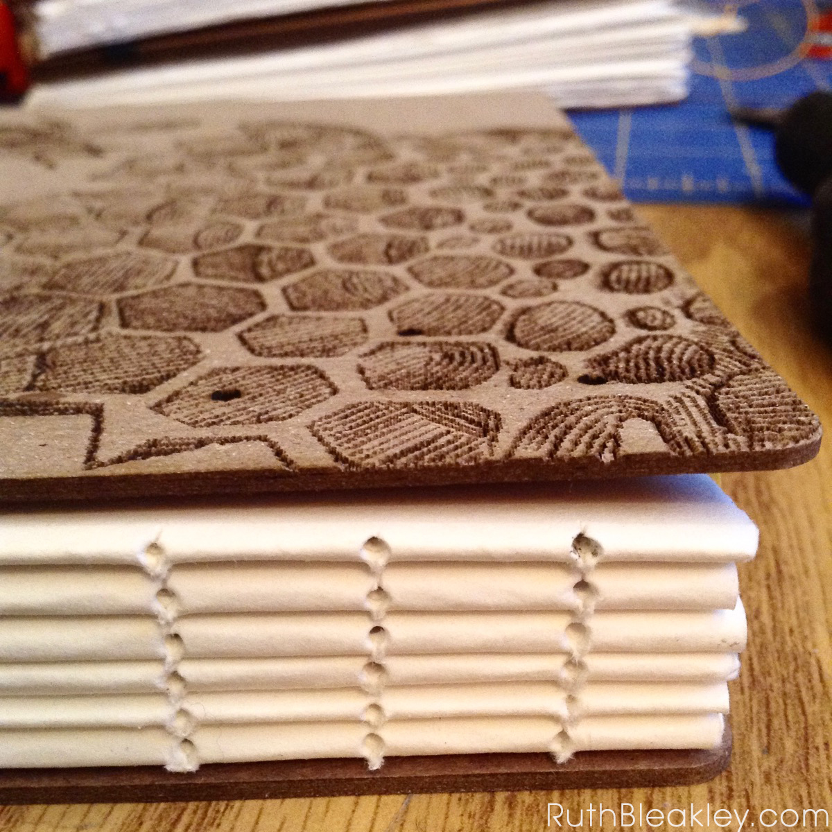 Honeybee Watercolor Sketchbook handmade by Ruth Bleakley with laser engraved cover - bookbinding sewing holes