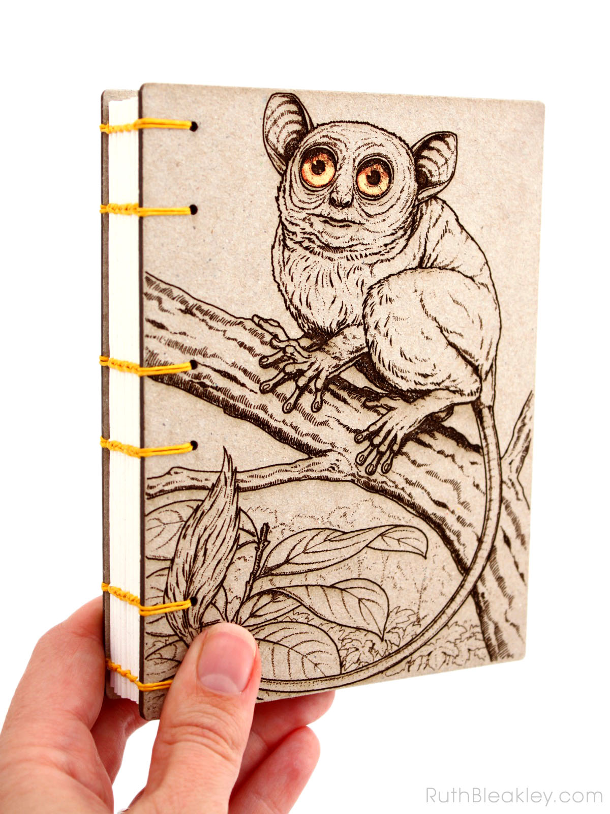 Koboldmaki laser engraved journal handmade by book artist Ruth Bleakley - with golden eyes