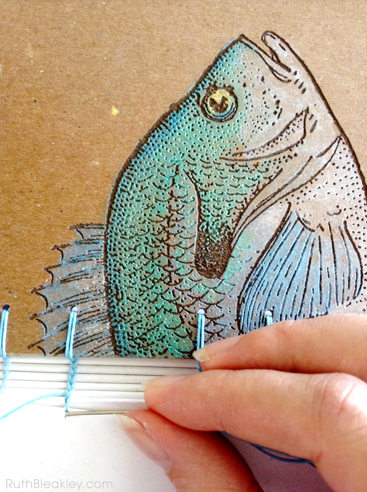 Sewing books by hand - Fish Journal made by bookbinder Ruth Bleakley