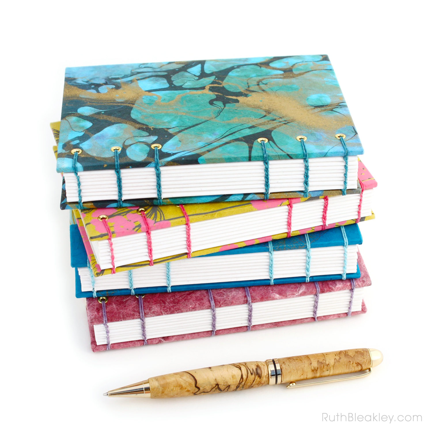 Stack of handmade blank journals handmade by Ruth Bleakley suitable for sketching or writing