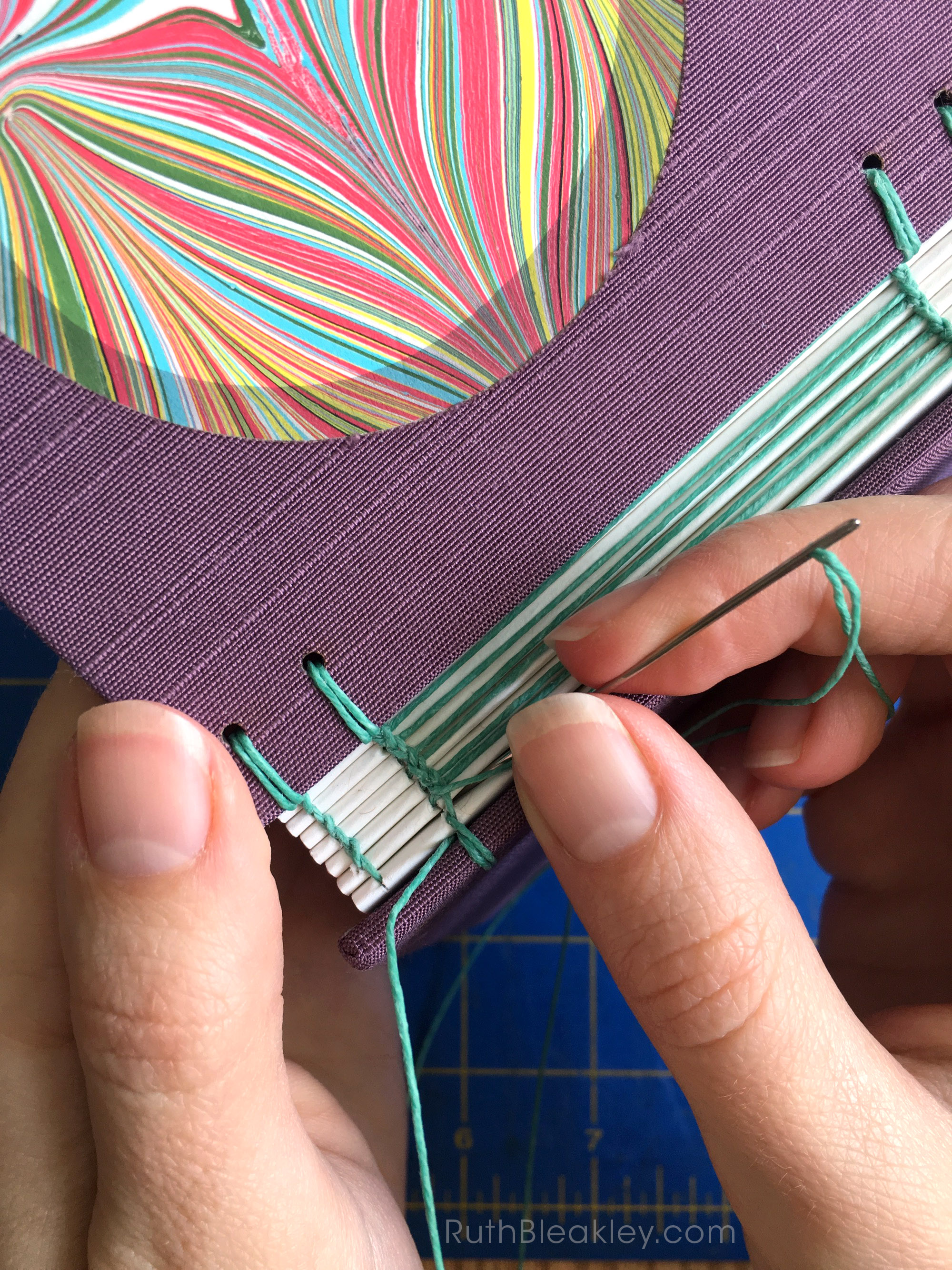 sewing a book together bookbinding process by Ruth Bleakley